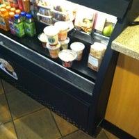 Photo taken at Starbucks by Victoria M. on 8/4/2012