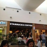 Photo taken at Starbucks by Jorge G. on 7/15/2012