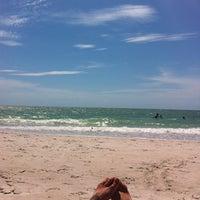 Photo taken at Vanderbilt Beach by April S. on 4/18/2012