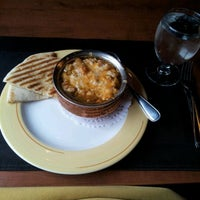 Photo taken at Thandi's Restaurant by Raymond S. on 5/2/2012