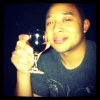 Photo taken at Linger Cafe & Lounge by Nilsa R. on 5/12/2012