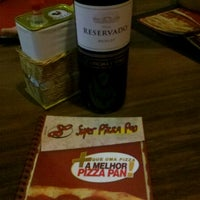 Photo taken at Super Pizza Pan by Lucas A. on 9/9/2012