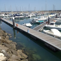 Photo taken at Oeiras Yacht Harbour by Rute G. on 5/15/2012