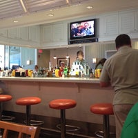 Photo taken at Islander Bar & Grill by Ashley S. on 8/13/2012