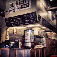 Photo taken at Burger 7 by Nawaf A. on 5/22/2012