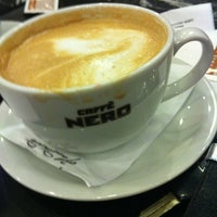 Photo taken at Caffè Nero by Ozan A. on 5/10/2012