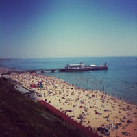 Photo taken at Bournemouth Beach by Jonathan R. on 7/26/2012