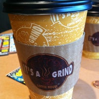 Photo taken at The Grind Coffee House-N-Café by Alexa M. on 3/31/2012
