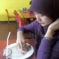 Photo taken at oLive Fried Chicken by Rizky B. on 6/4/2012