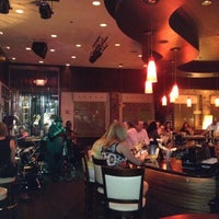 Photo taken at Vines Grille & Wine Bar by Chris M. on 8/24/2012