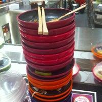 Photo taken at YO! Sushi by Brett on 5/20/2012
