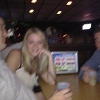 Photo taken at Huskies Restaurant & Bar by Ellen T. on 3/9/2012