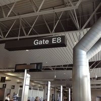Photo taken at Gate E8 by Keith D. on 6/1/2012