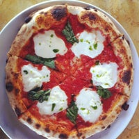 Photo taken at Olio Wood Fired Pizzeria by Kelly B. on 3/23/2012