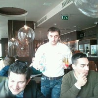 Photo taken at Giusto Restaurant & Bar by Magdi A. on 2/14/2012
