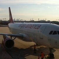 Photo taken at Gate E3 by Nicole M. on 6/9/2012