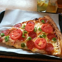 Photo taken at Cameli's Gourmet Pizza Joint by M N. on 8/18/2012