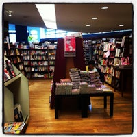 Photo taken at Kinokuniya Book Store by Eric T. on 7/31/2012