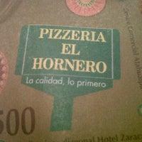 Photo taken at Pizzeria el Hornero by Esteban R. on 5/9/2012