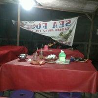 Photo taken at Seafood 98 Nasi Uduk by Kibow A. on 2/29/2012