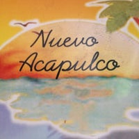 Photo taken at Nuevo Acapulco by Tim L. on 8/6/2012