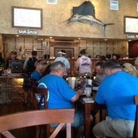 Photo taken at Uncle Mick's Cajun Market & Cafe by JoAnn J. on 7/21/2012