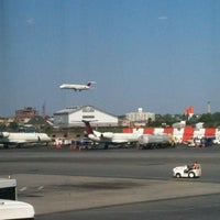 Photo taken at Gate D5 by Nacho A. on 7/24/2012