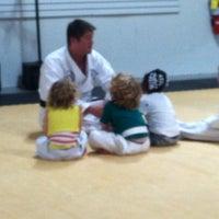 Photo taken at White Tigers Martial Arts Academy by Gloria E. on 8/30/2012