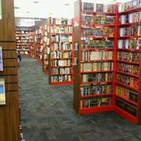Photo taken at Bookmans by David O. on 4/28/2012