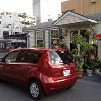 Photo taken at 日産レンタカー 那覇店 by Ryan T. on 8/11/2012
