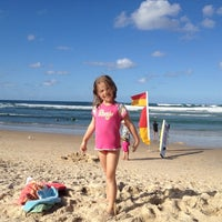 Photo taken at Cabarita Beach by Mike G. on 4/6/2012