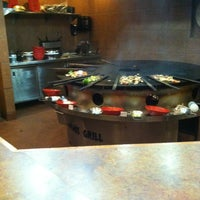 Photo taken at Genghis Grill by Miriam M. on 5/10/2012