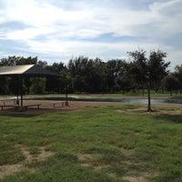 Photo taken at Bill Archer Dog Park by Felix T. on 7/24/2012