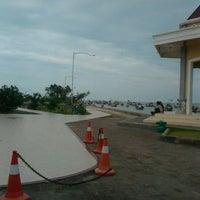Photo taken at Pantai Boom Tuban by Ritaa on 3/18/2012