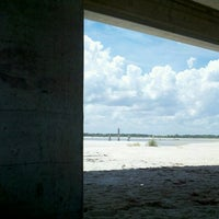Photo taken at Matanzas Inlet Under The Bridge On The Beach by Larry H. on 7/21/2012