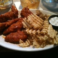 Photo taken at Pluckers Wing Bar by Donald C. on 6/14/2012