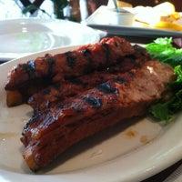 Photo taken at Thai Original BBQ Restaurant by Emma B. on 5/26/2012