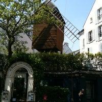 Photo taken at Le Moulin de la Galette by Andreas D. on 5/23/2012