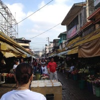 Photo taken at Dangwa Flower Market by Paolo S. on 7/14/2012