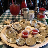 Photo taken at McGarvey's Saloon & Oyster Bar by Roxanne R. on 4/13/2012