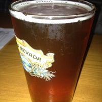 Photo taken at The Lodge Beer and Growler Bar by Tyler D. on 8/15/2012