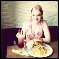 Photo taken at Retro Café by Michelle on 8/23/2012