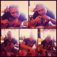 Photo taken at Mang Inasal by Kay E. on 7/21/2012