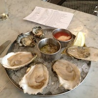 Photo taken at Neptune Oyster by Watanabe H. on 5/2/2012