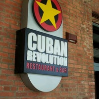 Photo taken at Cuban Revolution by Andreia O. on 5/28/2012