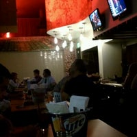 Photo taken at Traditions Bar & Grill by Eric on 8/21/2012