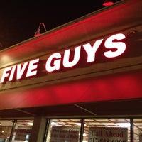 Photo taken at Five Guys by Sarah D. on 3/4/2012
