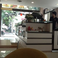 Photo taken at Panana Café by Chariya P. on 3/17/2012