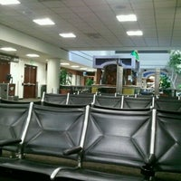 Photo taken at Terminal 1 by T L. on 6/21/2012