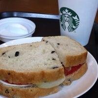 Photo taken at Starbucks by philomenus k. on 8/28/2012